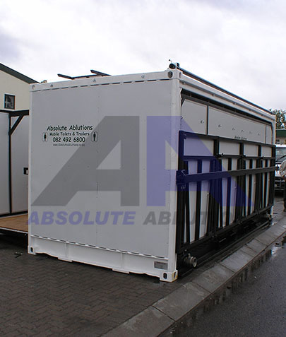 Container sized ablution block with fold down and slide out sections/panels to increase useable area, three fold – this unit included 12 toilets, 4 urinals, 6 basins and a storage area.