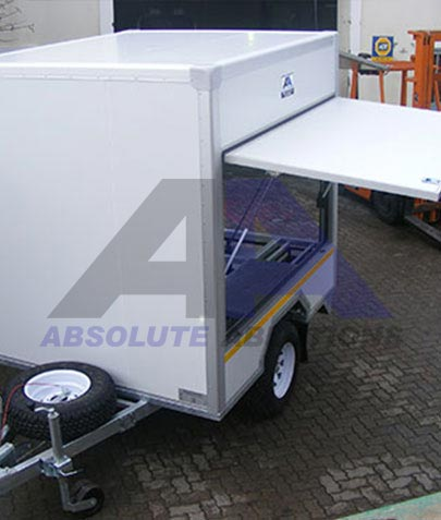 Large braked purpose designed trailer with a combination of hatches and stands for field filtration unit or workshop capacity of 3500 kg