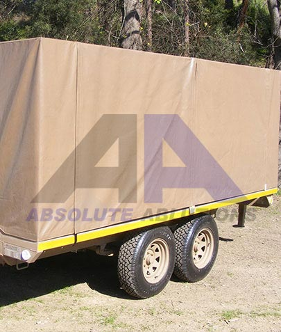 A 3500 kg capacity multi purpose load trailer with removable canopy with special suspension and flexible/ adjustable coupler designed to minimize shock load transfer between truck and trailer