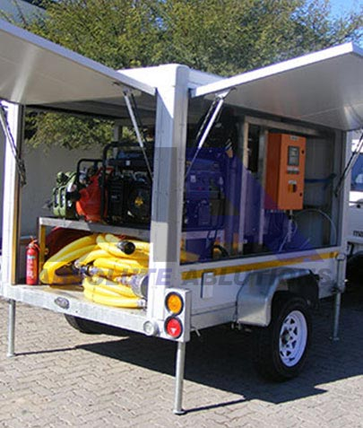 Small purpose designed trailer with hatches and stands for display, mobile workshop, filtration unit or other service type unit.
